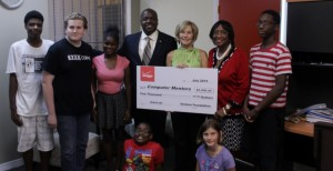 Debby Kampert of Verizon surrounded by Florida Representative Edwin Narain and Florida Senator Arthenia Joyner along with students from KidsCode and STEM Coprs summer camps.
