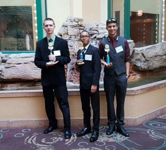 Pictured: Steven Fisher, Javier Harris, and Patrick Lester pose with their Second Place trophy for Digi-Sale, a digital yard sale platform for mobile devices.